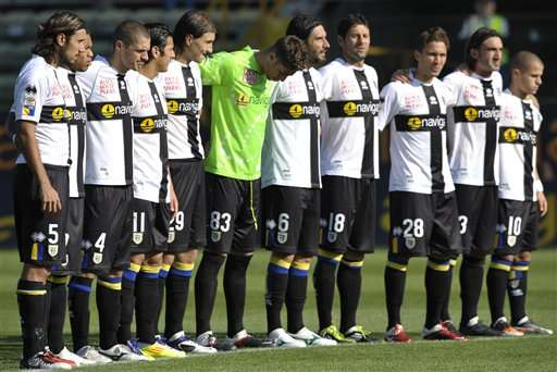 Parma's players hold a minute of silence for Italian Motogp rider Marco Simoncelli prior to the start of a serie A soccer match between Parma and Atalanta at Parma Tardini stadium, Italy, Sunday, Oct. 23, 2011. The Malaysian MotoGP has been stopped off Sunday after Italian Marco Simoncelli died in an accident involving Valentino Rossi of Italy and American Colin Edwards. (AP Photo/Marco Vasini)