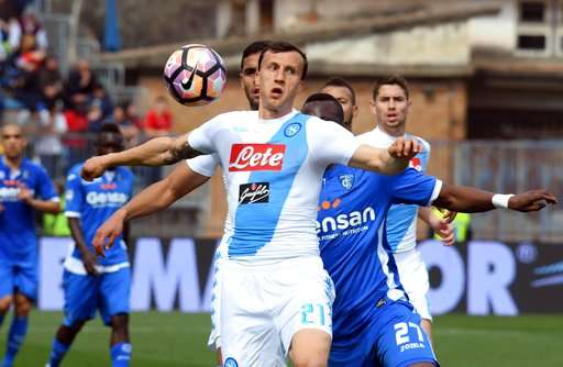Napoli's defender Vlad Chiriches, front, controls the ball during a Serie A soccer match between Empoli and Napoli at the Carlo Castellani Stadium in Empoli, Italy, Sunday, March 19, 2017 (Claudio Giovannini/ANSA via AP)