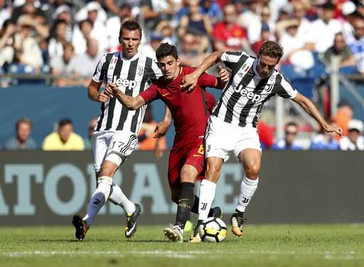 IMAGE DISTRIBUTED FOR INTERNATIONAL CHAMPIONS CUP - Juventus' Claudio Marchisio, right, controls the ball ahead of pressure from AS Roma's Diego Perott, center, as teammate Mario Mandzukic, left, defends during the first half of the International Champions Cup match on Sunday, July 30, 2017, in Foxborough, Mass. (Damian Strohmeyer/AP Images for International Champions Cup)
