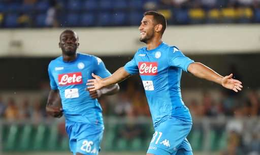 Napoli's Faouzi Ghoulam celebrates after scoring  during a Serie A soccer match between Hellas Verona and Napoli at the Bentegodi stadium in Verona, Italy, Saturday, Aug. 19, 2017. (Filippo Venezia/ANSA via AP)