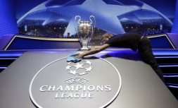A man cleans the logo of UEFA Champions League before the UEFA Champions League draw at the Grimaldi Forum, in Monaco, Thursday, Aug. 24, 2017. (AP Photo/Claude Paris)