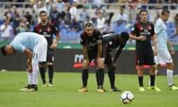 AC Milan's Leonardo Bonucci, foreground, and teammates react after Lazio's Ciro Immobile scored, during a Serie A soccer match between Lazio and AC Milan, at the Rome Olympic stadium, Sunday, Sept. 10, 2017. (AP Photo/Alessandra Tarantino)