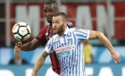 Spal's Mirco Antenucci and AC Milan's Cristian Zapata, left, go for the ball during the Serie A soccer match between AC Milan and Spal, at the Milan San Siro Stadium, Italy, Wednesday, Sept. 20, 2017. (AP Photo/Antonio Calanni)