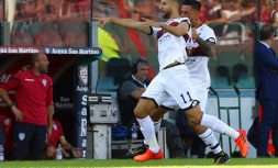 Genoa's Adel Taarabt, left, celebrates after scoring during the Serie A soccer match between Cagliari and Genoa, in Cagliari, Italy, Sunday, Oct. 15, 2017. (Fabio Murru/ANSA via AP)