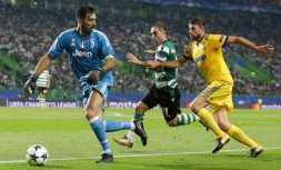 Sporting's Bruno Cesar, center, challenges for the ball with Juventus' Andrea Barzagli, right, and Juventus goalkeeper Gianluigi Buffon during a Champions League, Group D soccer match between Sporting CP and Juventus at the Alvalade stadium in Lisbon, Tuesday Oct. 31, 2017. (AP Photo/Armando Franca)