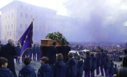 The coffin leaves the church in a purple smoke screen at the end of the funeral ceremony of Italian player Davide Astori in Florence, Italy, Thursday, March 8, 2018. The 31-year-old Astori was found dead in his hotel room on Sunday after a suspected cardiac arrest before his team was set to play an Italian league match at Udinese. (AP Photo/Alessandra Tarantino)
