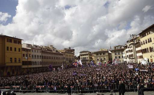 People stand outside the church during the funeral ceremony of Italian player Davide Astori in Florence, Italy, Thursday, March 8, 2018. The 31-year-old Astori was found dead in his hotel room on Sunday after a suspected cardiac arrest before his team was set to play an Italian league match at Udinese. (AP Photo/Alessandra Tarantino)