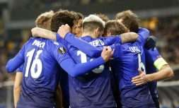 Lazio's players gather around Lazio's Lucas Leiva, 2nd right, as they celebrate his opening goal during the Europa League round of 16, second-leg soccer match between Dynamo Kiev and Lazio at the Olympiyskiy stadium in Kiev, Ukraine, Thursday, March 15, 2018. (AP Photo/Efrem Lukatsky)