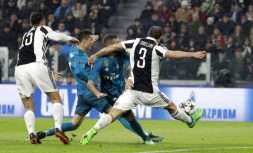 Real Madrid's Cristiano Ronaldo, second left, scores the opening goal of his team during the Champions League, round of 8, first-leg soccer match between Juventus and Real Madrid at the Allianz stadium in Turin, Italy, Tuesday, April 3, 2018. (AP Photo/Luca Bruno)