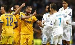 Real Madrid's Cristiano Ronaldo argues with Juventus' Gonzalo Higuain during a Champions League quarter final second leg soccer match between Real Madrid and Juventus at the Santiago Bernabeu stadium in Madrid, Wednesday, April 11, 2018. (AP Photo/Francisco Seco)