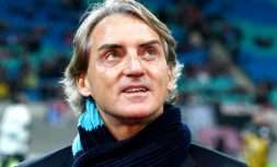 "FILE - in this Thursday, March 8, 2018 file photo, Zenit St. Petersburg manager Roberto Mancini looks up prior to the Europa League round of sixteen first leg soccer match between RB Leipzig and FC Zenit St. Petersburg in Leipzig, Germany. Roberto Mancini is the top candidate to become Italy's coach after Carlo Ancelotti reportedly turned down the job. Mancini tells RAI state radio, ""There has not been contact with the (Italian football) federation but for a coaching the Italian national team would be source of honor and prestige."" Italian media reported over the weekend that Ancelotti informed the federation that he was no longer interested. (AP Photo/Jens Meyer, File)"
