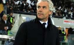 Bologna coach Roberto Donadoni walks on the pitch prior to a Serie A soccer match between Bologna and Udinese, at the Friuli stadium, Italy, Monday, Dec. 5, 2016. (Alberto Lancia /ANSA via AP)
