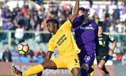 Verona's Moise Kean, left, is challenged by Fiorentina's German Pezzella during the Serie A soccer match between Fiorentina and Hellas Verona at the Artemio Franchi Stadium in Florence, Italy, Sunday, Jan. 28, 2018. (Maurizio Degl'Innocenti/ANSA via AP)