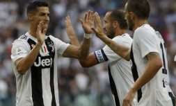 Juventus' Cristiano Ronaldo, left, celebrates with Juventus' Giorgio Chiellini, second right after their teammate Juventus' Miralem Pjanic scored the opening goal of the game during the Serie A soccer match between Juventus and Lazio at the Allianz Stadium in Turin, Italy, Saturday, Aug. 25, 2018. (AP Photo/Luca Bruno)