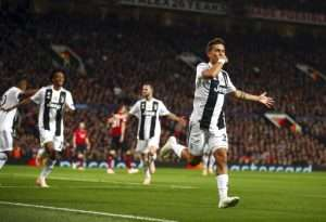 Paulo Dybala celebrates after scoring at Old Trafford.