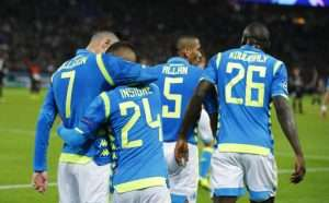 Insigne celebrates with his teammates after scoring the opening goal