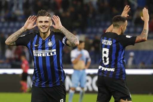 Inter Milan's Mauro Icardi, left, celebrates after he scored his side's third goal during a Serie A soccer match between Lazio and Inter Milan, at Rome's Olympic stadium, Monday, Oct. 29, 2018. (AP Photo/Alessandra Tarantino)