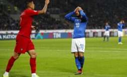 Italy's Lorenzo Insigne, right, reacts after missing a scoring chance during the UEFA Nations League soccer match between Italy and Portugal at the San Siro Stadium, in Milan, Saturday, Nov. 17, 2018. (AP Photo/Antonio Calanni)