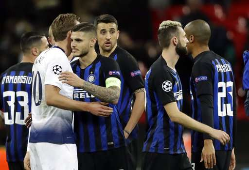 Tottenham forward Harry Kane, left, and Inter forward Mauro Icardi hug at the end of a Champions League group B soccer match between Tottenham Hotspur and Inter Milan at Wembley stadium in London, Wednesday, Nov. 28, 2018. (AP Photo/Matt Dunham)